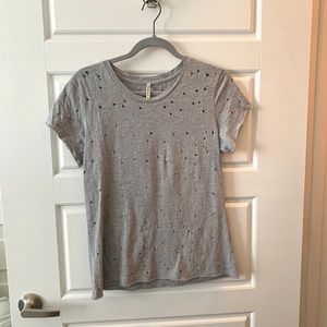 grey t shirt with holes